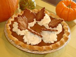 Pumpkin Pie Topped with Whipped Cream Dollups